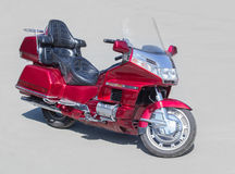 Red motorcycle on asphalt Stock Photography