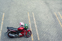 Red Motorcycle on empty car parking pavement. With white and green helmet. Photographs taken on highway toll road rest area. Concept of travelling, long royalty free stock photos
