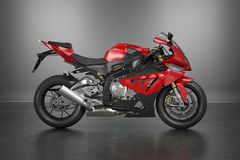 Sport Motorcycle. Red motorcycle on grey background Royalty Free Stock Photography