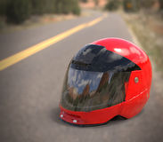 Red motorcycle helmet. On the ground on the road royalty free illustration
