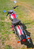 Red motorcycle on meadow Royalty Free Stock Photography