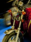 Red motorcycle in motion. Front wheel of a red motorcycle in motion Royalty Free Stock Images