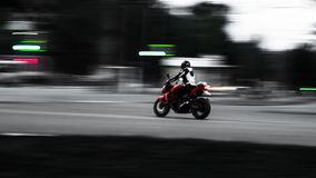 Red motorcycle. In motion. Photo with minimal wiring. stock photos