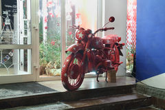 Red motorcycle near shop Stock Photo