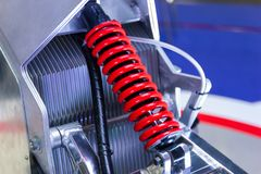 Red Motorcycle shock Absorbers. A device for absorbing jolts and vibrations stock image