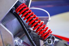 Red Motorcycle shock Absorbers. A device for absorbing jolts and vibrations stock photo