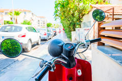Red motorcycle stands on the sidewalk Royalty Free Stock Photo