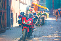 Red motorcycle at the summer cafe on a sunny day Royalty Free Stock Photo