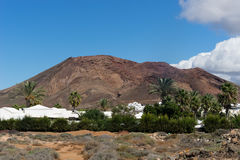The red mountain as seen from the south. Actually it is a volcano and there is pathway all around the top of the volcano with great views of the surroundings stock images