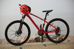 Red mountain bike and helmet Royalty Free Stock Photo