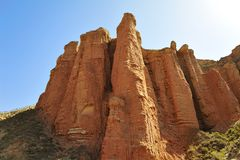 Red mountain canyon. Mountains with red color under morning sunshine, located in Qilian mountains Stock Photos