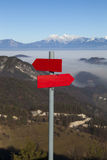 Red mountain guidepost along an alpine pathway Stock Images