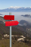 Red mountain guidepost along an alpine pathway Royalty Free Stock Photography