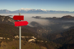 Red mountain guidepost along an alpine pathway Royalty Free Stock Photos