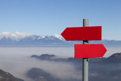 Red mountain guidepost along an alpine pathway Stock Photo