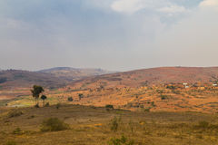 Red mountain landscape with blue sky in a Madagascar Royalty Free Stock Photo