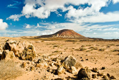 Red mountain. Roja Montana the red mountain on the north east of Fuerteventura Royalty Free Stock Images