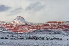 Red mountain with snow haze at sunset Stock Photo