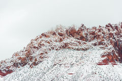 Red mountain with snow haze at sunset Royalty Free Stock Image