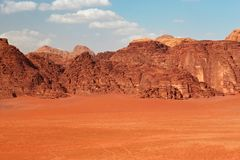 Red mountains of the canyon of Wadi Rum desert in Jordan. Wadi Rum also known as The Valley of the Moon is a valley cut into the sandstone and granite rock in royalty free stock photo