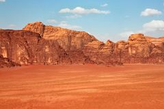 Red mountains of the canyon of Wadi Rum desert in Jordan. Wadi Rum also known as The Valley of the Moon is a valley cut into the sandstone and granite rock in stock photos