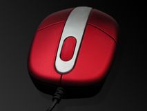 Red mouse. On a digital black background with a little shadow Stock Photo