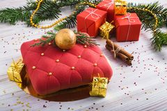 Red mousse cake and festive gift boxes stock image