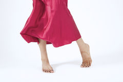 Red Moving Skirt and feet. Dancing Red moving skirt and feet with mehndi tattoo stock photography