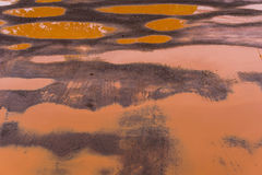 The Red Mud Road has many wells, sagging roads.  Royalty Free Stock Image