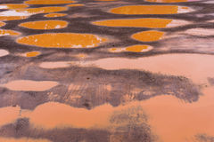 The Red Mud Road has many wells, sagging roads Royalty Free Stock Images