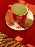 Red mug. Empty red cup on decorated saucer Stock Photography