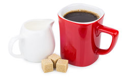 Red mug coffee, sugar cubes and milk jug on white Royalty Free Stock Photos