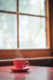 Red mug coffee and window Royalty Free Stock Photography