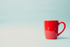 Red mug on grunge green wall Royalty Free Stock Images