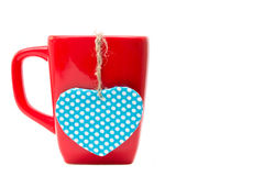 Red mug with heart shape isolated on white background Stock Photo