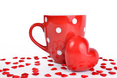 Red mug and heart Stock Images