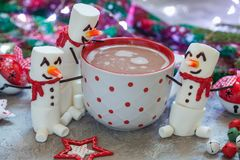 Hot chocolate with melted snowman Royalty Free Stock Image