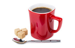 Red mug with hot coffee, sugar cubes and spoon Stock Photo