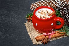 Red mug with hot white chocolate and cinnamon Royalty Free Stock Photography