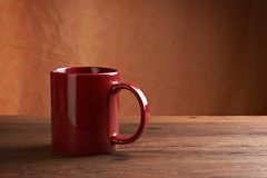 Red mug on wooden tabletop Royalty Free Stock Photo