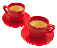 Red Mugs. Two small red coffee mugs with espresso royalty free stock photo