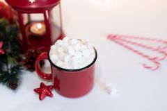 Red mugs with hot chocolate and marshmallows and gingerbread cookies. Christmas concept.  royalty free stock image
