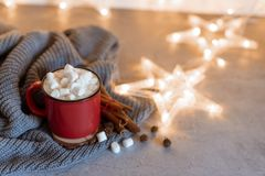 Red mugs with hot chocolate and marshmallows and gingerbread cookies. Christmas concept.  royalty free stock images