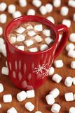 Red mugs with hot chocolate and marshmallows Stock Images