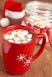Red mugs with hot chocolate and marshmallows Royalty Free Stock Image