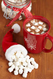 Red mugs with hot chocolate and marshmallows Royalty Free Stock Images
