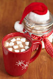 Red mugs with hot chocolate and marshmallows Stock Photography