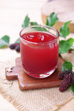 Red mulberry juice on the table Royalty Free Stock Photos