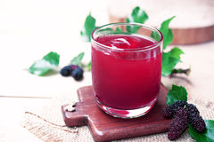 Red mulberry juice on the table Stock Images