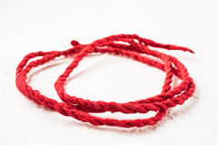 Red mulberry paper rope. On white isolated Stock Photo